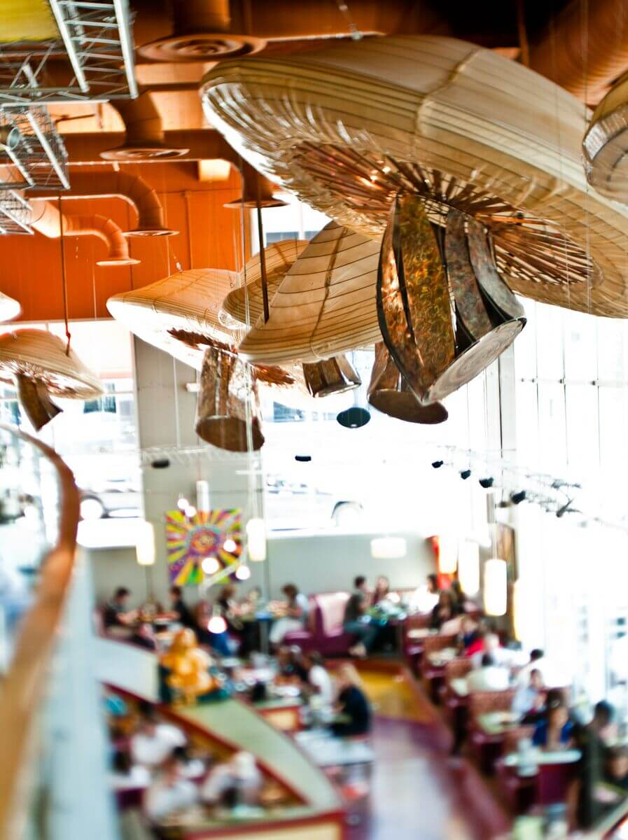 Mellow Mushroom Downtown Atlanta - hanging mushroom sculptures over main dining area from second floor dining space