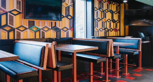 Mellow Mushroom Decatur GA - booths with geometric walls televisions