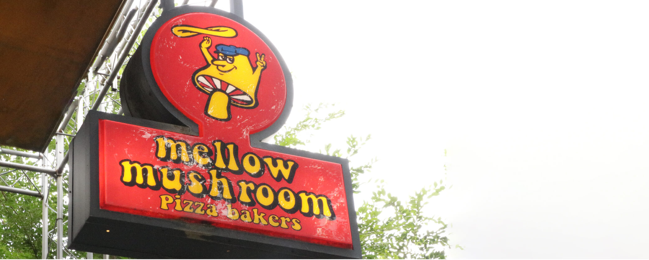 Mellow Mushroom Downtown Atlanta - patio signage under yellow awning