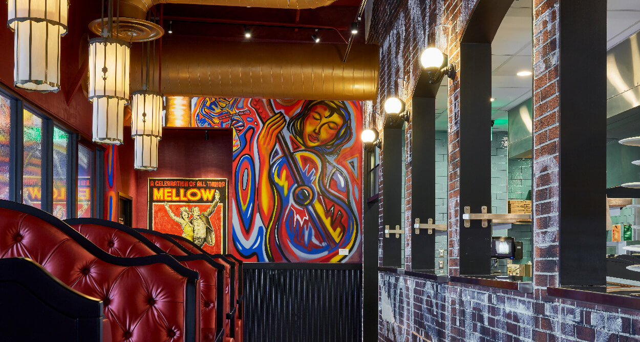Mellow Mushroom Short Pump - Virginia - red booths and vibrant mural windows into kitchen