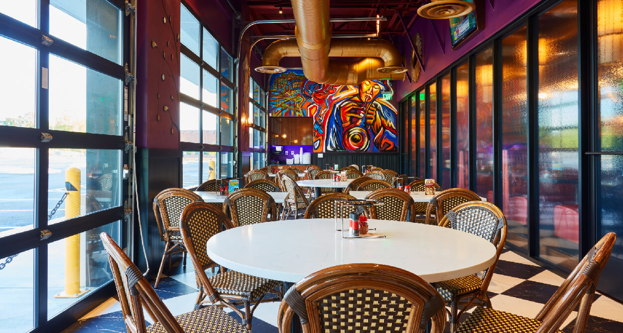 Mellow Mushroom Short Pump - Virginia - private room garage door wall white tables wicker chairs