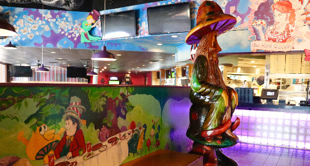 Mellow Mushroom Brookhaven mural and mel wizard statue