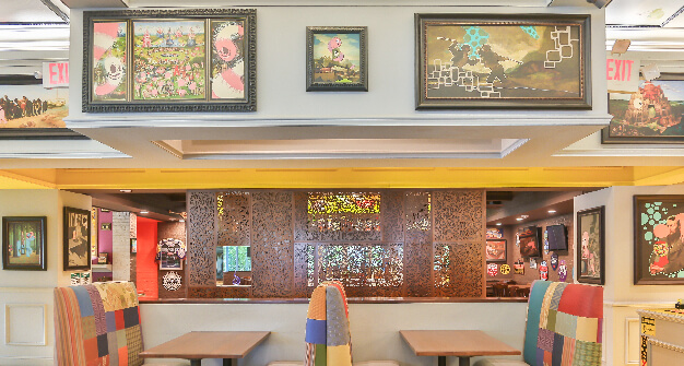 Mellow Mushroom Cary dining booths store art