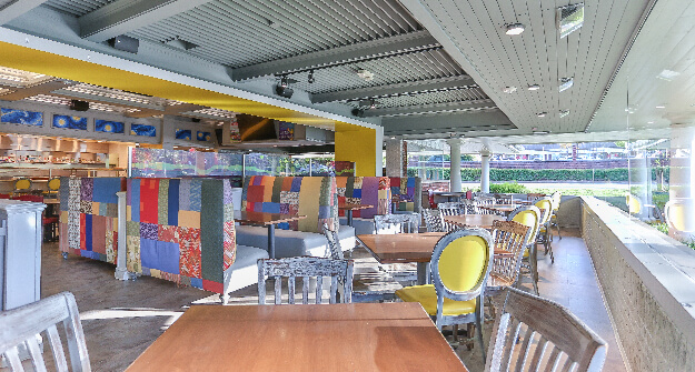 Mellow Mushroom Cary main dining tables wrap around windows