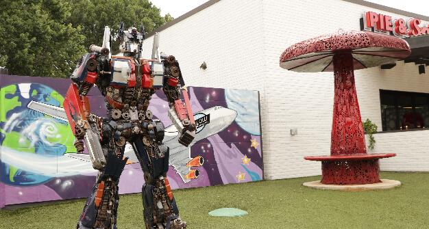 Mellow Mushroom College Park exterior art optimus statue