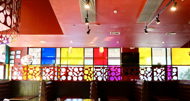 Mellow Mushroom Cumming GA booths and colored windows