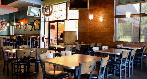 Mellow-Mushroom-Kennesaw-interior-steating-tables-and-wood-chairs