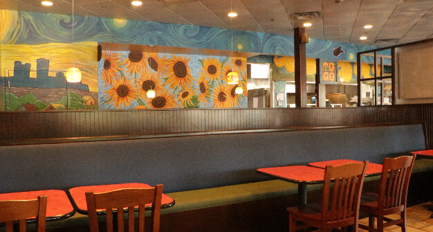 Mellow Mushroom Northlake main dining tables and mural