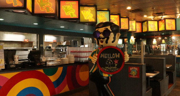 Mellow Mushroom Powers Ferry interior feature statue with sign