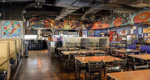 Mellow Mushroom Raleigh murals main dining booths and tables