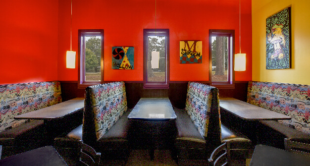 Mellow Mushroom Wake Forest dining booths and wall paintings