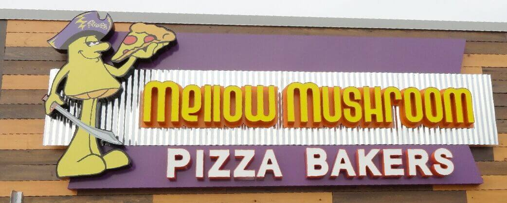Store information Mellow Mushroom Greenville NC exterior sign pirate theme