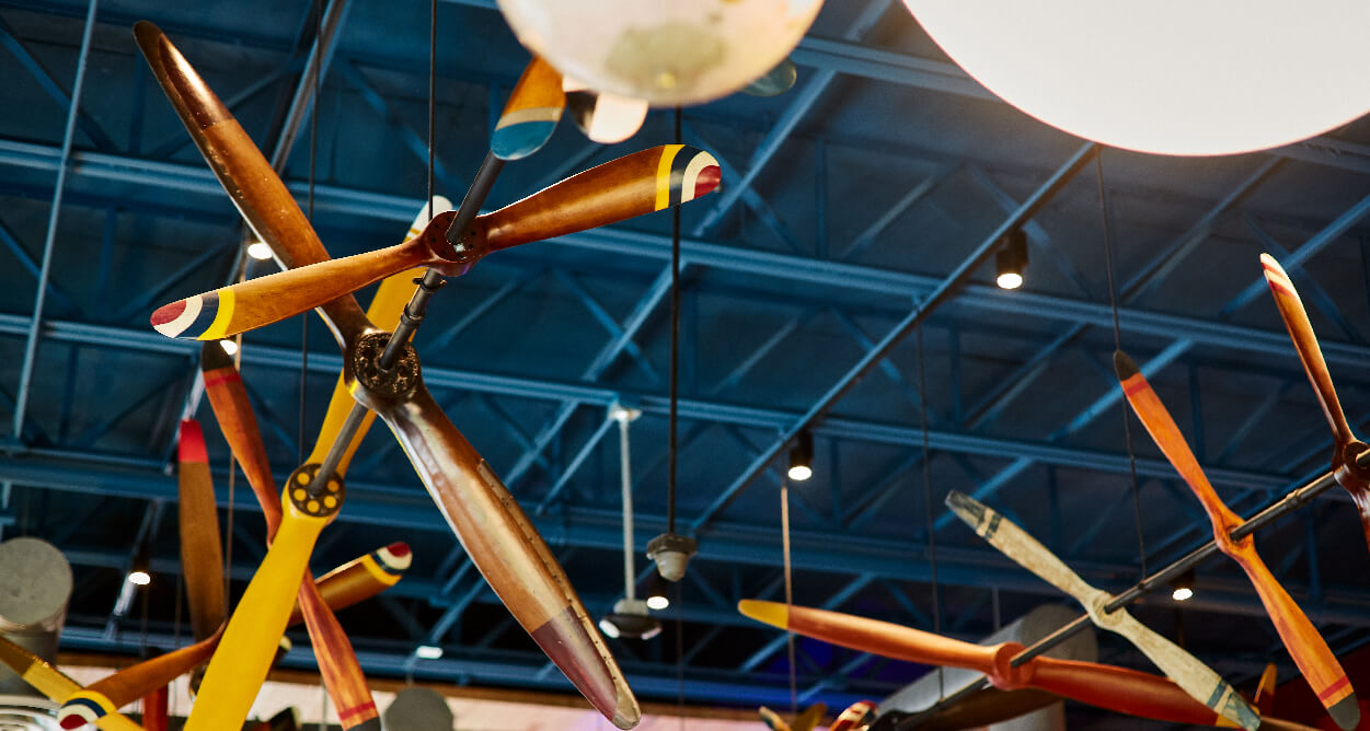 Mellow Mushroom Chantilly - plane propellers hanging from ceiling feature art