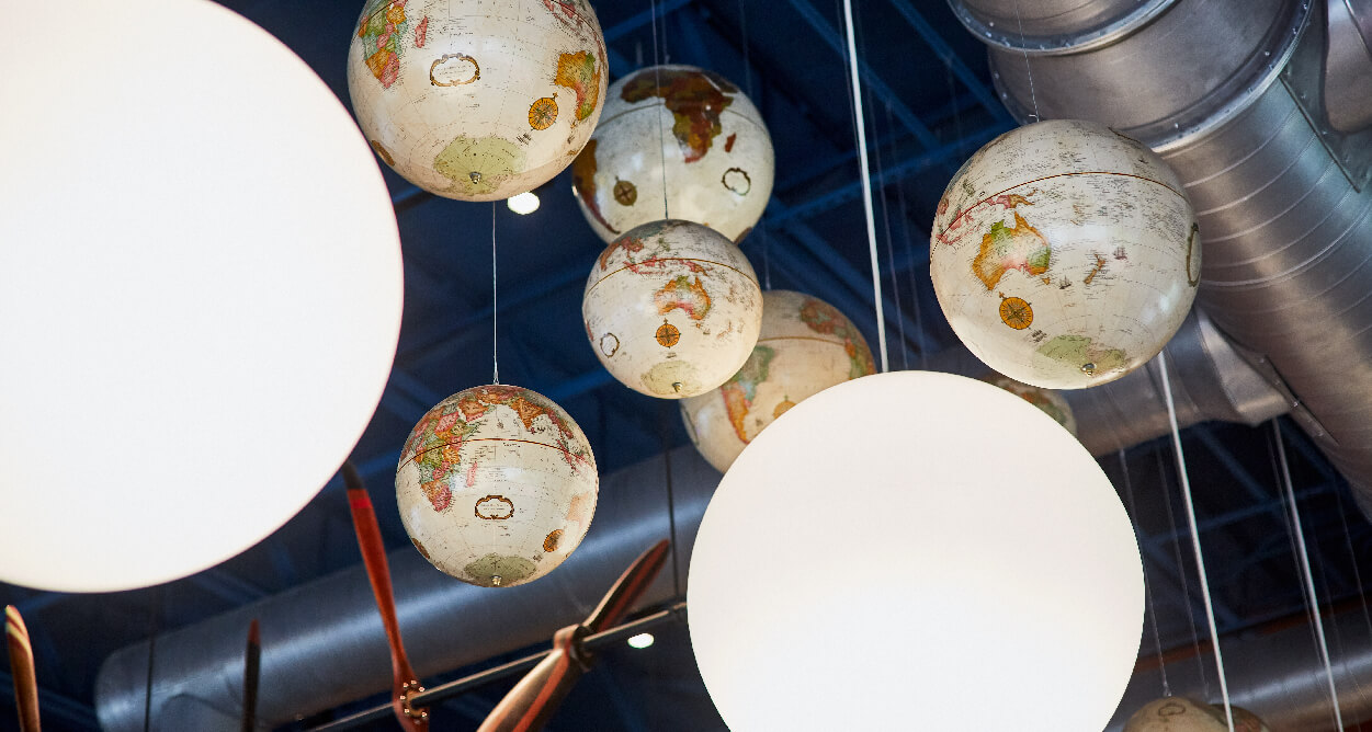 Mellow Mushroom Chantilly - hanging globes from ceiling aviation theme art