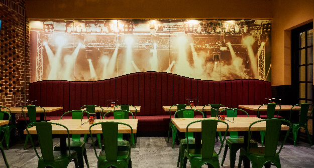 Mellow Mushroom Willaimsburg concert theme mural and main dining green chairs red booth