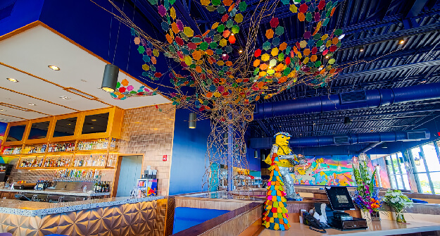 Mellow Mushroom Estero host stand feature art tree