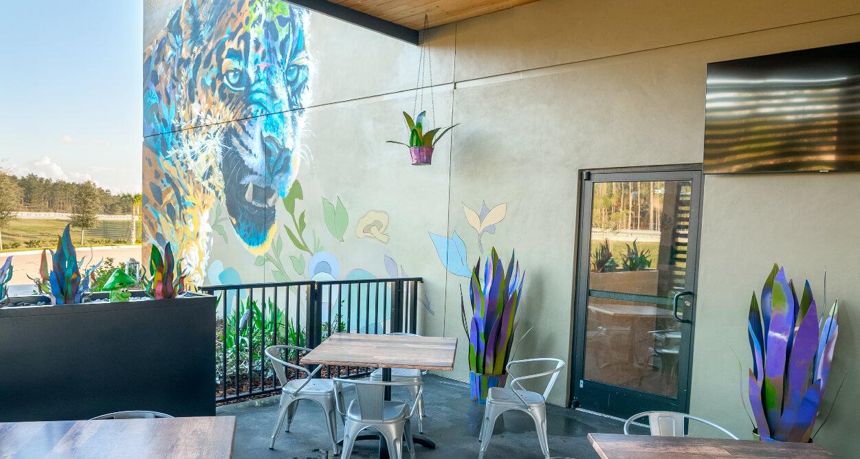 Mellow Mushroom Durbin Park St Johns patio mural jaguar outdoor dining